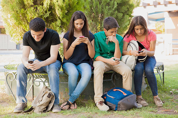 Group of teenagers texting