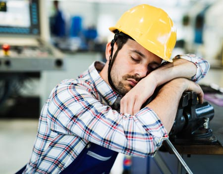 Man falling asleep at work